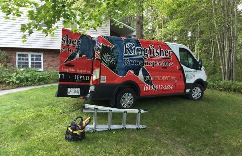 Kingfisher Inspections red, white, and blue truck alonside a ladder and toolbox