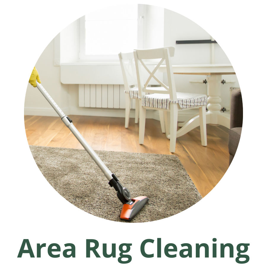 silver and orange vaccume being used to clean a grey area rug