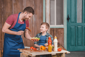 Father and son cooking on father's day.